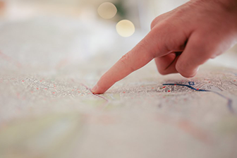 Image of a finger on a map
